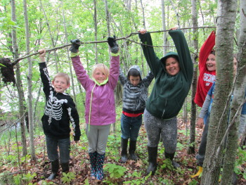Fourth graders from Northern Lights Elementary remove buckthorn from Clough Island